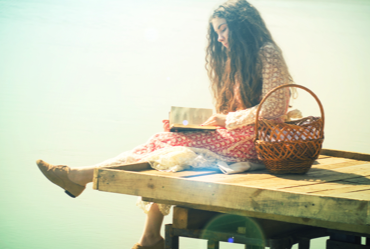 Woman-Reading-Book-Outside-Water-Dock-Basket-470-Feature